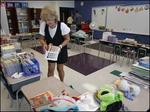 Second grade teacher Kay Pommeranz readies her classroom for the start of the school year.