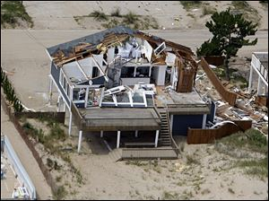 This aerial photo taken Sunday shows damage to a home in Virginia Beach, Va., after a reported tornado, spurned by Hurricane Irene, ripped through the area Saturday.