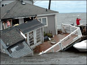 A Fairfield Beach Road home is submerged in Pine Creek in Fairfield, Conn. as treacherous weather caused by Tropical Storm Irene came through the area on Sunday.