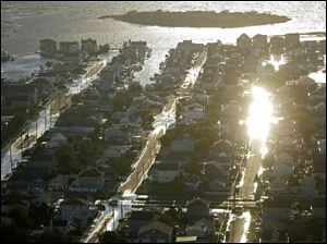 Streets of Long Beach Island, N.J. are flooded after Hurricane Irene moved through the area. Rivers and creeks surged toward potentially record levels late Sunday as Irene, just the third hurricane to come ashore in New Jersey in the past 200 years, charged to the north and left behind a mess and a sense that the state got off relatively easy.