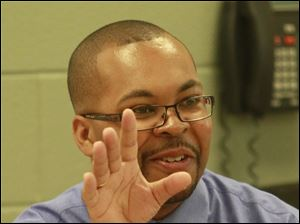 Robinson Elementary School Principal Anthony Bronaugh gestures for emphasis while talking to students on the first day of classes Monday, Aug. 29.
