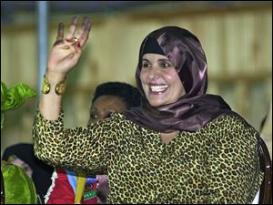 Safiya Gadhafi, the wife of Libyan leader Moammar Gadhafi, seen here in 2003, fled to Algeria Monday.