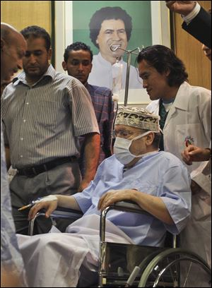 In this Sept. 9, 2009 file photo, Libyan Abdel Baset al-Megrahi, who was found guilty of the 1988 Lockerbie bombing is seen below a portrait of Libyan Leader Moammar Gadhafi.