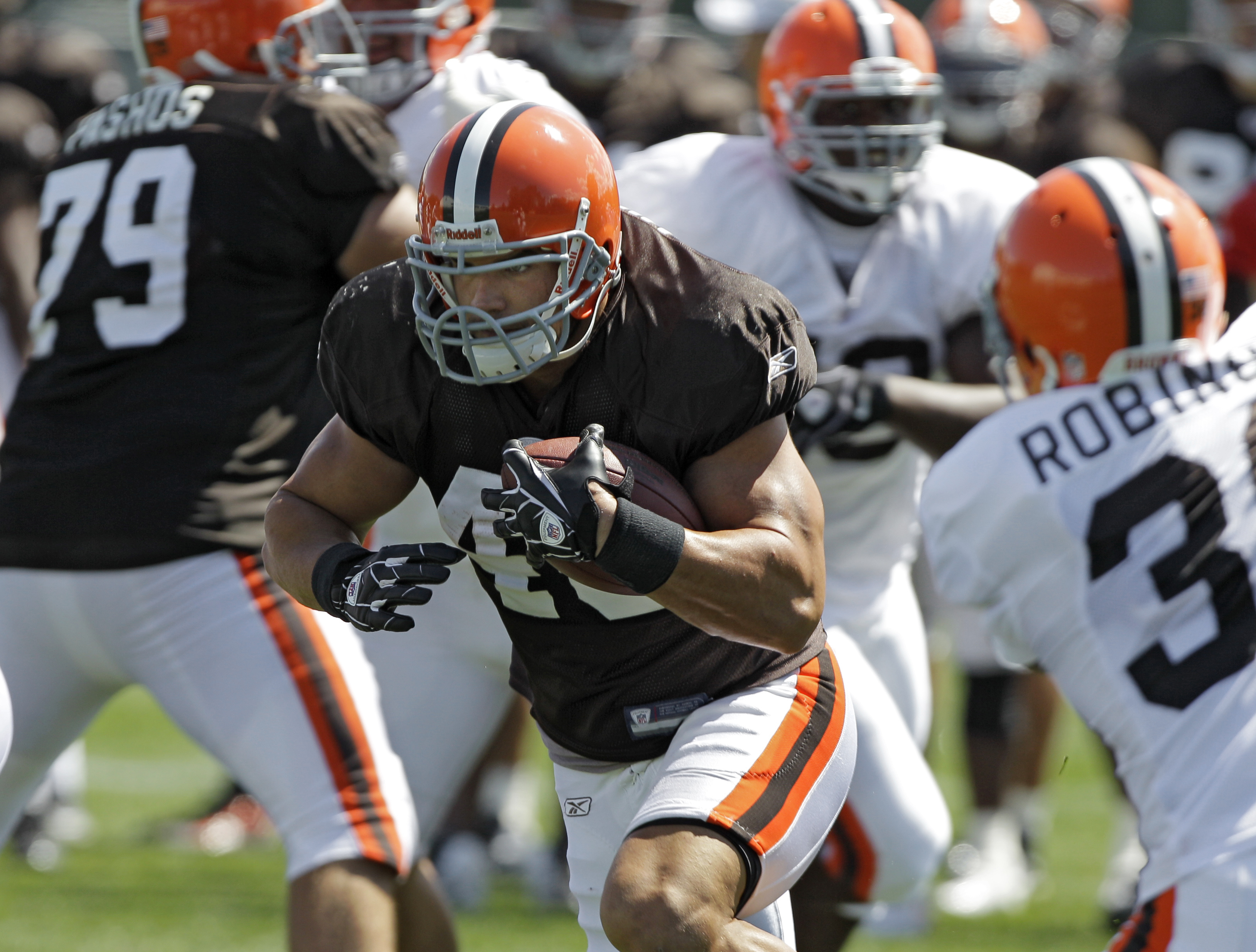On The Cover Browns Running Back Peyton Hillis Hands Out