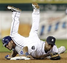Ramon-Santiago-Mike-Moustakas-Tigers-complete-double-play