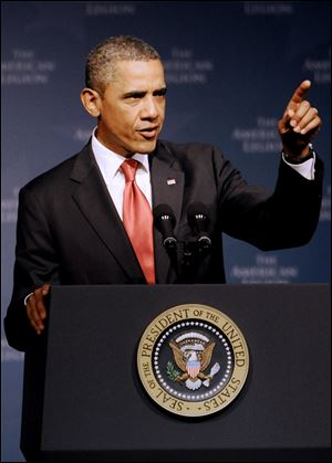 President Barack Obama addresses the national convention of the American Legion. Tuesday, Aug. 30, 2011, in Minneapolis.