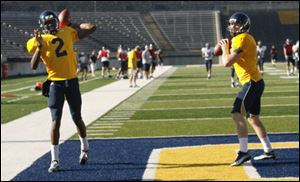 Austin Dantin, right, will start at quarterback for Toledo, but Terrance Owens, left, will play as well.