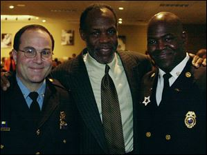Police Chief Mike Navarre, Danny Glover and and Fire Chief Mike Bell at Gladieux Meadows for a benefit for the Toledo Hospital on Feb. 28, 2002.