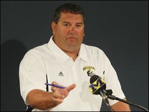 University of Michigan football head coach Brady Hoke gave his players trident pitchforks like pins given to Navy SEALs.