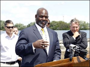 Mayor Mike Bell speaks during a press conference at the new solar field at the Collins Park water treatment plant in East Toledo, which treats water for the entire city on August 10, 2011.