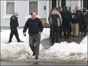 Chief Mike Navarre leaves a residence where a suspect was found Feb. 21, 2007, after the killing of TPD vice detective Keith Dressel on the corner of Ontario and Bush streets in North Toledo.