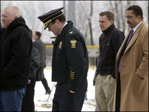 Police chief Mike Navarre, councilman Frank Szollosi, and Mayor Jack Ford, right, were among those gathered Feb. 16, 2005, in Ravine Park II to pause for a moment of silence in remembrance of the four workers killed  on the I-280 bridge project.  A construction crane collapsed on February 16, 2004. The Blade/Dave Zapotosky