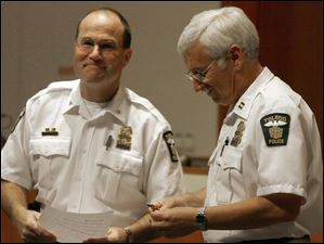 Toledo Police Chief Mike Navarre promotes Michael D. Murphy to deputy chief July 28, 2006, at the Lucas County Commissioner's chambers.