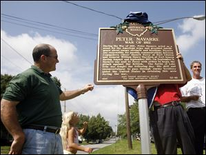 Police Chief Mike Navarre unveils a historical marker Sept. 9, 2007, during the 200th Bicentennial Celebration of when East Toledo was founded by Peter Navarre and his brothers.