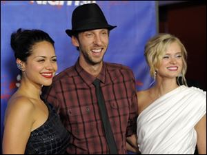 """Shark Night 3D"" cast members, from left, Alyssa Diaz, Joel David Moore and Sara Paxton pose together before a screening of the film in Los Angeles."