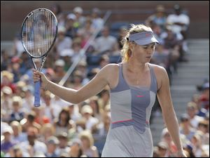A frustrated Maria Sharapova of Russia reacts after a point in her three-set defeat to Italy's Flavia Pennetta.