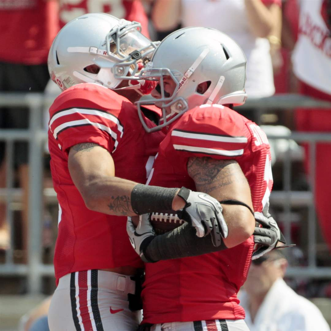 Ohio-State-Jake-Stoneburner-celebrates-with-Verlon-Reed