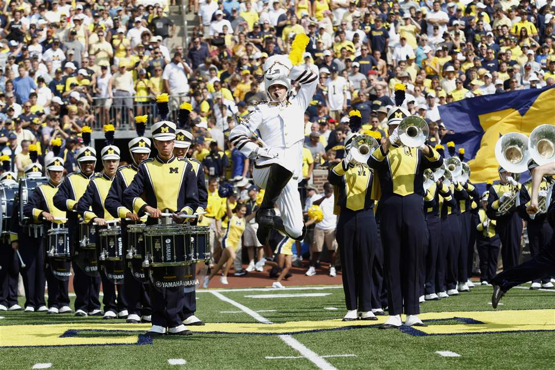 Michigan-band-walks-onto-the-field-Jeffrey-McMahon