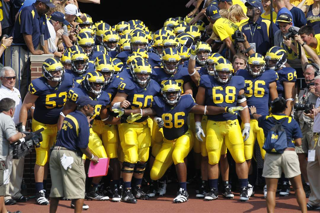 Michigan-players-set-to-storm-field-Kevin-Koger
