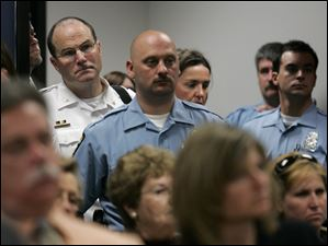 An overflow crowd of spectators, many of them Toledo police officers, including Chief Mike Navarre, attend a May 15, 2007, hearing of Robert Jobe,  charged with shooting and killing Toledo police Detective Keith Dressel, in Lucas County Juvenile Court for the second phase of his certification hearing to determine whether he would be tried as an adult.