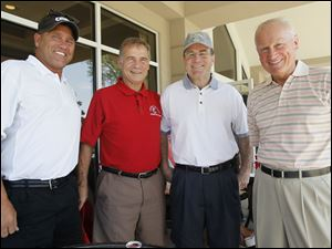 Joe Westhoven, from left, Jabo Ginter, Toledo Police Chief Mike Navarre, and retired Mayor Carty Finkbeiner, all of Toledo, attend the Merrill Lynch-ProMedica Kids Unlimited Celebrity Golf Classic at Highland Meadows Golf Club in Sylvania on June 13, 2011.