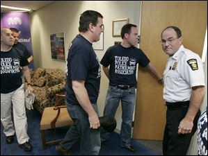 Chief Navarre meets with laid-off Toledo police officers outside the mayor's office May 14, 2009.