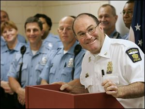Chief Navarre, surrounded by school resource officers, is all smiles as he thanks Ohio Attorney General Richard Cordray for a Special Drug Use Prevention Grant awarded to the Toledo Police Department, during a press conference at the Scott Park district police station June 11, 2009.