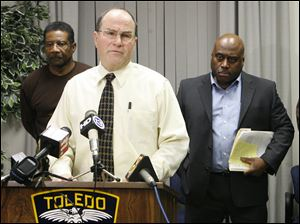 Police Chief Mike Navarre, flanked by Lt. Bill Moton, from left, Deputy Chief Derrick Diggs, and Sgt. Tim Campbell, talks about Vincent Vernell Williams being arrested for a string of serial rapes.