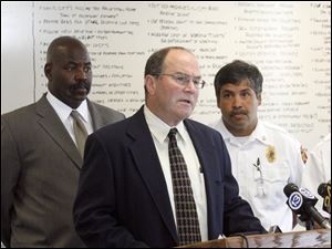 Police Chief Navarre speaks to the media about the rash of arsons in Toledo Mayor Mike Bell, from left, Assistant Toledo Fire Chief Luis Santiago, and Fire Chief Mike Wolever look on July 16, 2010.