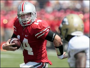 Ohio State quarterback Joe Bauserman (14) runs the ball  against Akron during the second  quarter.