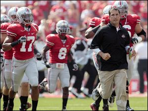Ohio State head coach Luke Fickell leads the Buckeyes onto the field against Akron in Columbus on Saturday.