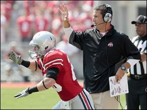 Ohio State  head coach Luke Fickell gives instructions during the first quarter Saturday.