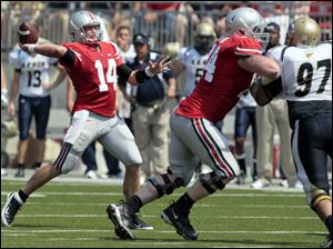 Ohio State quarterback Joe Bauserman (14) throws a touchdown pass to Jake Stoneburner (11) against  Akron during the second quarter.o.