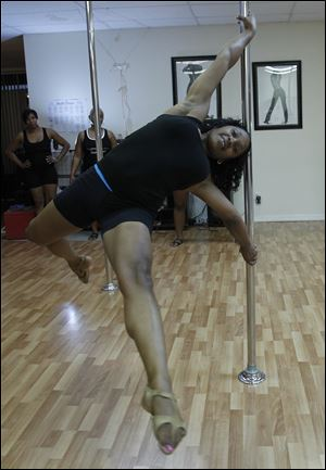 Tarsha Gott swings around the pole.
