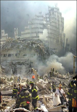 A shell of what was once part of the facade of one of the twin towers of New York's World Trade Center rises above the rubble that remains after both towers were destroyed in the terrorist attacks Sept. 11, 2001.