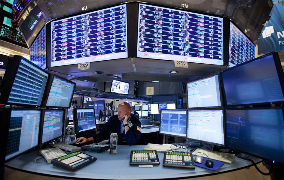 New-York-Stock-Exchange-trader-looks-at-screen