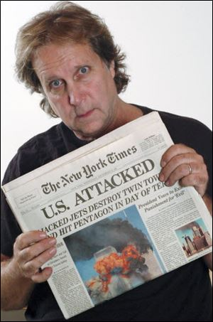Former Toledoan Rocky Pinciotti, a photographer, displays the banner headline about the attacks.