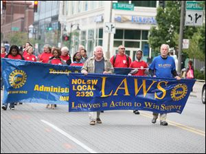 National Organization of Legal Services Workers Local 2320 participates in Monday's parade.
