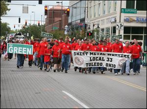 Sheet Metal Workers Local 33 march down Adams Street past North Superior.