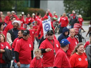 Members of UAW Local 12 wear red shirts urging voters to vote against the anti-collective bargaining law in November.