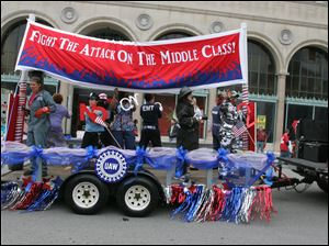 A Labor Day float filled with people dressed as various members of public unions urges Ohioans to vote down Issue 2 in November.