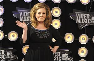 Adele arrives at the MTV Video Music Awards on Sunday Aug. 28, 2011, in Los Angeles.