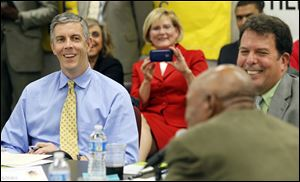 U.S. Secretary of Education Arne Duncan, left, listens during a mock peer review session at the Toledo Federation of Teachers headquarters on South Byrne Road. His visit Wednesday was part of a Midwest tour to view reforms.