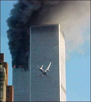 A jet airliner is lined up on one of the World Trade Center towers in this Sept. 11, 2001, file photo.