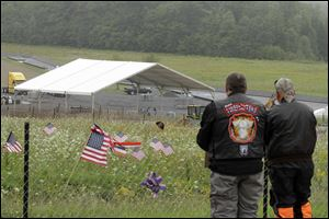 Visitors overlook the temporary memorial to Flight 93 in Shanksville, Pa.