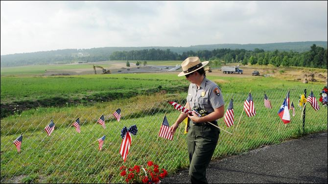 Wendy Clay Flight 93 memorial Park Ranger Wendy Clay removes items from the Flight 93 temporary memorial to be archived earlier this summer. There will be 40 trees in the memorial grove of the yet-to-be-completed Flight 93 National Memorial near Shanksville, Pa. The trees represent each of the passengers and crew members who died.
