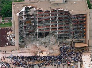 Thousands of search and rescue crews attend a memorial service May 5, 1995, in front of the Alfred P. Murrah Federal Building in Oklahoma City, after an explosion killed 168 people and injured  hundreds more April 19, 1995.