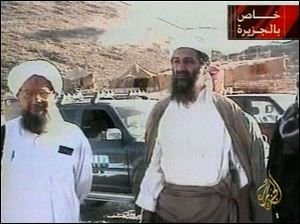"Osama bin Laden is shown at an undisclosed location on Sept. 11, 2001, in this video image released by Al-Jazeera television Oct. 5, 2001. Al-Jazeera did not say whether the image was taken before or after the Sept. 11 attacks on the United States or how it was obtained. At left is Bin Laden's top lieutenant, Egyptian Ayman al-Zawahri. Graphic at top right reads ""Exclusive to Al-Jazeera."" At bottom right is the station's logo which reads ""Al-Jazeera."""
