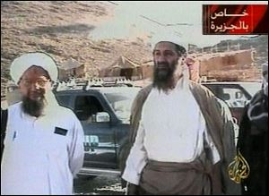 Osama bin Laden is shown at an undisclosed location on Sept. 11, 2001, in this video image released by Al-Jazeera television Oct. 5, 2001. Al-Jazeera did not say whether the image was taken before or after the Sept. 11 attacks on the United States or how it was obtained. At left is Bin Laden's top lieutenant, Egyptian Ayman al-Zawahri. Graphic at top right reads