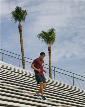 Former Arizona State golfer Pat Moore runs the bleachers at Arizona State University early in Tempe, Ariz.